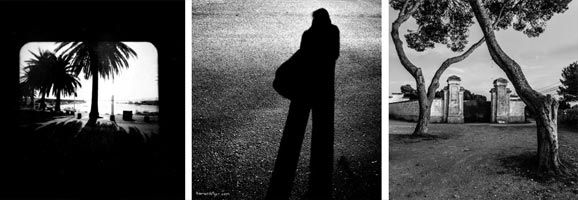 Fotografia del cartell d'exposició de fotografía de Joan Petrus, Toni camps, Manolo Sosa, i Tomàs Rotger